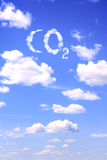 Symbol CO2 from clouds. On blue sky Stock Images