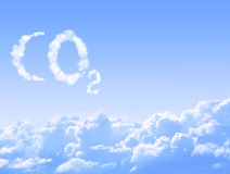 Symbol CO2 from clouds. On blue sky backrgound Stock Images