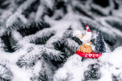 Symbol 2017-cock. On snow-covered fir branches stock photo