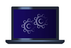 Symbol of the cogwheels on the laptop computer Stock Image