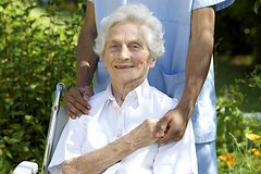 Symbol of comfort and support from a care giver to the Senior Stock Images