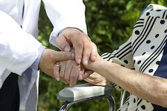 Symbol of comfort with supporting and compassionate hands Stock Photos