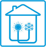 Symbol conditioner in home with sun and snowflake Stock Photos