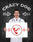 911 symbol. Crazy doctor holding poster with no 911 symbol Stock Photos