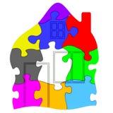 Symbol des Hauses gemacht von den bunten Puzzlespielen Stockfoto