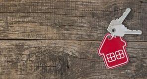 Symbol des Hauses mit silbernem Schlüssel Stockfotografie
