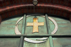 Symbol on the door of church. Stock Photos