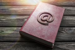Symbol of e-mail, book, on the background stock photography
