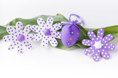 Symbol of Easter holidays - flowers and eggs on green leaf. And line Stock Photos