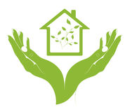 A symbol eco houses in female hands. Stock Image