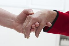Symbol of elderly help. The helping hands for elderly home care Stock Photography