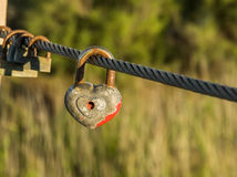 Symbol of eternal love. Old rusty padlocks on metal cable. Royalty Free Stock Photos