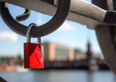 Symbol of eternal  love. A padlock with a heart, symbol of love, hanging from a bridge in Berlin, Germany Royalty Free Stock Photo