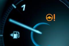 Symbol för varningsljus i bilinstrumentbräda arkivfoto