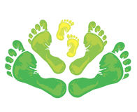 Symbol of family - foot print. Symbol of family - three green foot print from the father, mother and child Stock Photos