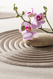 Symbol of femininity with pure flowers. Zen concept around female relaxation and meditation Royalty Free Stock Images