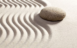 Symbol of feng-shui in sand and stone. Drawing waves in asian garden for meditation royalty free stock images