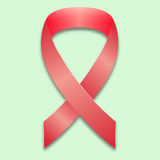 The symbol of the fight against breast cancer. Rose crossed by ribbon on a gentle green background. Royalty Free Stock Photos