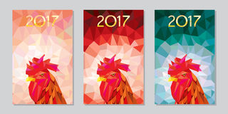 Symbol 2017 fire cock poligonal background three different color variations. Oriental symbol of calendar year Royalty Free Stock Images