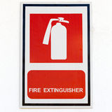 Symbol of fire extinguisher isolated on white wall Royalty Free Stock Photo