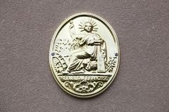 Symbol of french notary in France. Symbol of french notary on a wall in France royalty free stock images