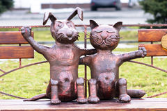 A symbol of friendship cat and dog statue. Symbol of friendship cat and dog figurine. Funny, comic picture Stock Photos