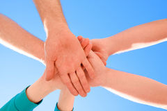 Symbol of friendship between people. Hands of people against the. Sky. Preparing for a team game Stock Photo