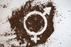 Symbol of gender equality made of ground coffee. White background stock images