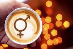 Symbol of gender equality. On milk foam coffee cups cappuccino royalty free stock photo
