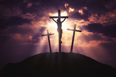 Symbol of God`s love to people. Image of Jesus crucifixion under sunbeam with three crucifixes on the hill, symbol of God`s love to people Stock Photography