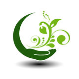 Symbol of green energy.  Circular natural element. Hand and flower with leaf. Nature icon. Stock Image