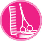 Symbol of hair salon with scissors and comb Stock Photography