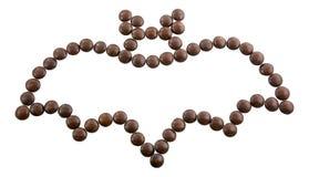 Symbol Halloween - ein Schläger Kontur wird von den runden Süßigkeiten gemacht Lizenzfreie Stockfotografie