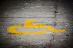 Handicap symbol printed on the street Stock Image