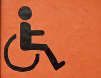 The symbol handicapped on wall Royalty Free Stock Photos