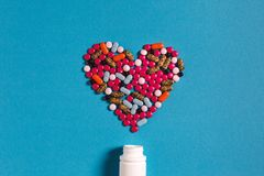 Symbol Heart From Color Pills Medicament On Blue Background. Creativity Medicine Concept. Symbol Heart From Color Pills Medicament On Blue Background, Top View royalty free stock images