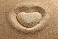 symbol of heart is drawn on clean sand Royalty Free Stock Photography