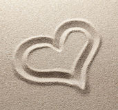 The symbol of heart is drawn on  sand Stock Photos