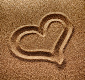 Symbol of heart is drawn on  sand Stock Image