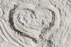 The symbol of heart is drawn on sand Royalty Free Stock Photo