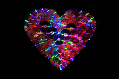 The symbol of the heart is lined with DVD discs. Royalty Free Stock Photography