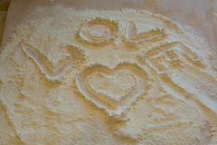 The symbol of heart and love painted on the flour. During cooking Royalty Free Stock Image