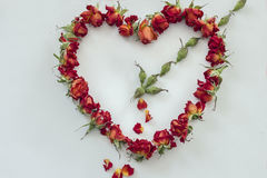 Symbol heart from roses pierced by Cupid's arrow Stock Image