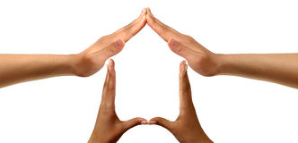 Symbol Home. Conceptual symbold home made from black and white hands isolated over white background