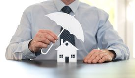 Concept of home coverage. Symbol of home coverage by a general agent Royalty Free Stock Image