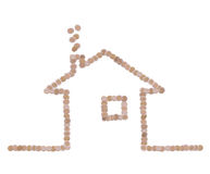 Symbol of home made of coins stock photo