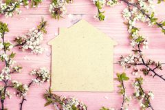 Symbol of the house with blossoming apple tree branches on pink Stock Photo