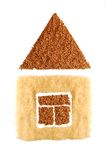 Symbol of the house from buckwheat and rice Royalty Free Stock Photos