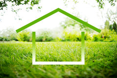 Symbol of House on a green landscape Stock Photography
