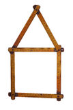 Symbol of house made of old yardstick Royalty Free Stock Photo